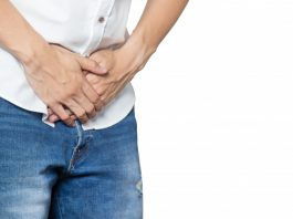 male-hands-holding-middle-crotch-trousers-with-prostate-inflammation_34168-339